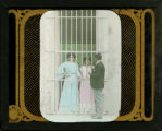 [Two Girls in behind a gate]
